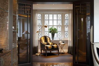 casa forma luxury interior design gold and black armchair & floor lamp in kensington gardens london
